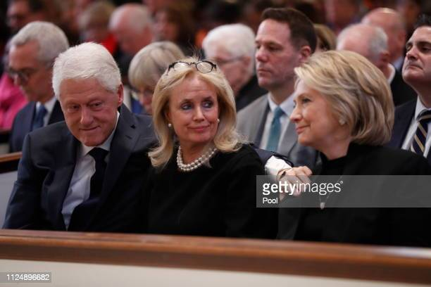 Rep. Debbie Dingell , center, talks with former U.S. President Bill Clinton and former Secretary of State Hillary Clinton during funeral services for...