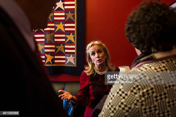 Rep. Debbie Dingell greets supporters during an open house at her office in the House Canon Office building on Capitol Hill on January 6, 2015 in...