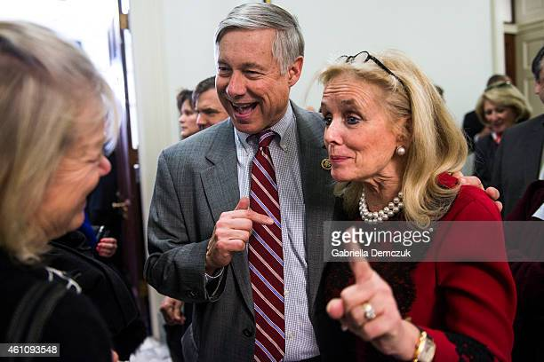 Rep. Debbie Dingell greets U.S. Rep. Fred Upton during an open house at her office in the House Canon Office building on Capitol Hill on January 6,...