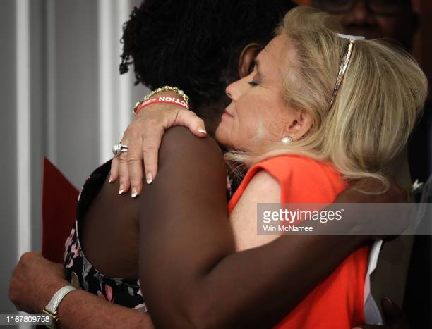 Rep. Debbie Dingell hugs Dr. Wendy Edmonds , who lost her sister in a shooting at the U.S. Navy Yard in Washington, during a press conference calling...
