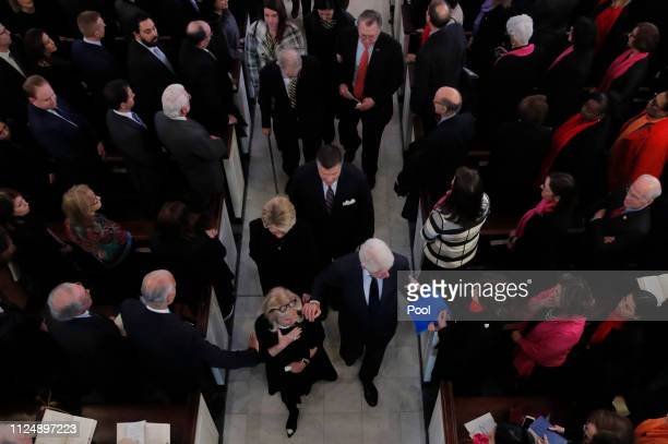 S Rep Debbie Dingell is greeted as she departs with former US President Bill Clinton former Secretary of State Hillary Clinton after a funeral mass...