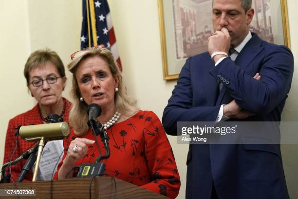 Rep. Debbie Dingell speaks as Rep. Marcy Kaptur and Rep. Tim Ryan listen during a news conference on auto jobs November 29, 2018 on Capitol Hill in...