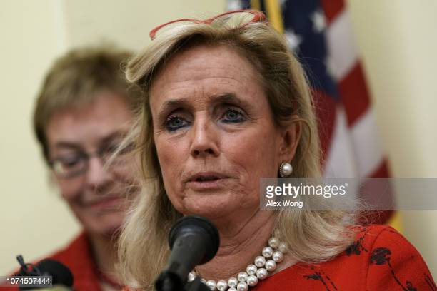 Rep. Debbie Dingell speaks as Rep. Marcy Kaptur listens during a news conference on auto jobs November 29, 2018 on Capitol Hill in Washington, DC....