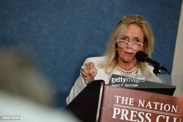 Rep. Debbie Dingell speaks at a news conference held by Save the US EPA September 13, 2017 in Washington, DC. Activists are speaking out against...