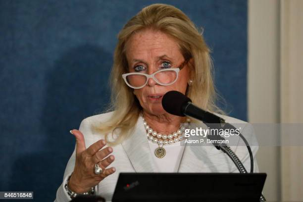 Rep Debbie Dingell speaks at a news conference held by Save the US EPA September 13 2017 in Washington DC Activists are speaking out against cutbacks...