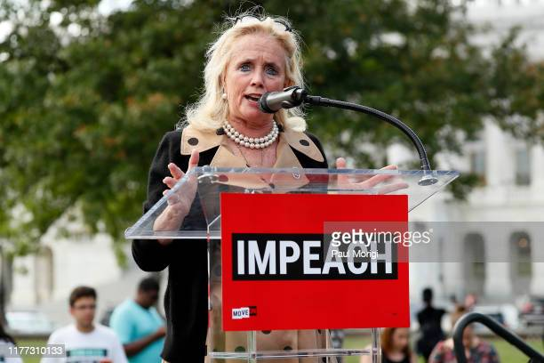 """Rep. Debbie Dingell speaks at the """"Impeachment Now!"""" rally in support of an immediate inquiry towards articles of impeachment against U.S. President..."""