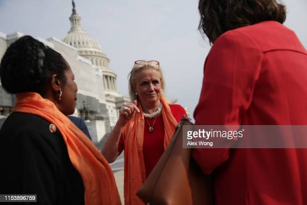 Rep. Debbie Dingell talks to Rep. Sheila Jackson-Lee prior to a photo opportunity June 5, 2019 on Capitol Hill in Washington, DC. Democratic...