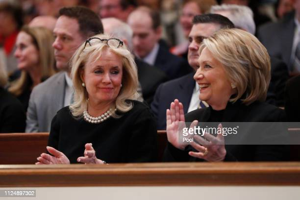 Rep Debbie Dingell talks with former Secretary of State Hillary Clinton during funeral services for her husband former Rep John Dingell on February...