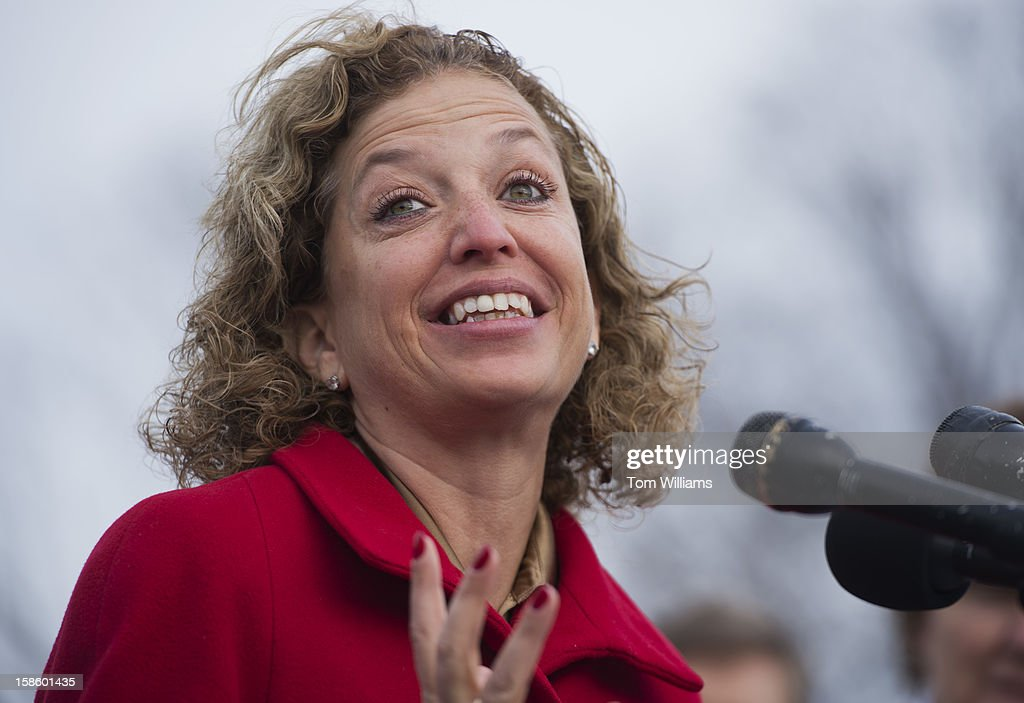 Rep. Debbie Wasserman Schultz, D-Fla., speaks at a news conference at the House Triangle with faith leaders to urge Congress to protect programs such as Social Security, Medicaid, and Medicare and call on lawmakers make sure 'everyone pays their fair share.'
