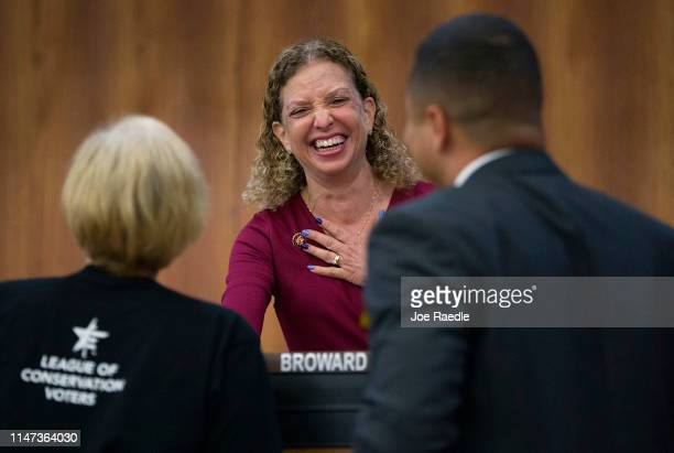 Rep Debbie Wasserman Schultz greets people before the start of the Elections Subcommittee field hearing on 'Voting Rights and Election Administration...