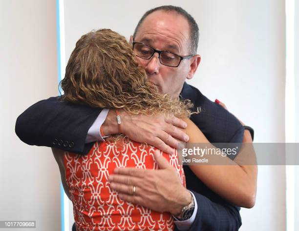 Rep Debbie Wasserman Schultz is hugged by Fred Guttenberg cofounder of the Orange Ribbons for Jaime during a press conference held at the Sunrise...