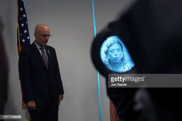 Rep Debbie Wasserman Schultz is seen in the viewfinder of a camera as Rep Ted Deutch listens to her speak during a press conference held at the...