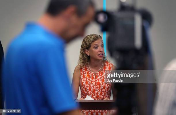Rep Debbie Wasserman Schultz listens as Rep Ted Deutch speaks during a press conference held at the Sunrise Police Department asking the federal...