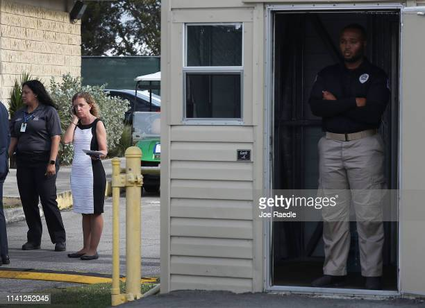 Rep Debbie Wasserman Schultz speaks on her cell phone after being denied access to visit the Homestead shelter for unaccompanied migrant children on...