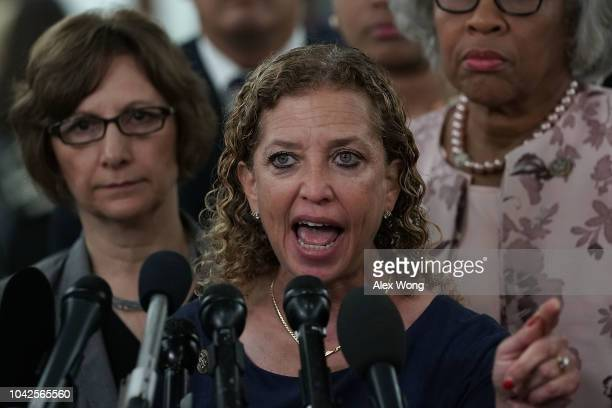 S Rep Debbie Wasserman Schultz speaks to members of the media as other female Democratic House members look on outside a Senate Judiciary Committee...