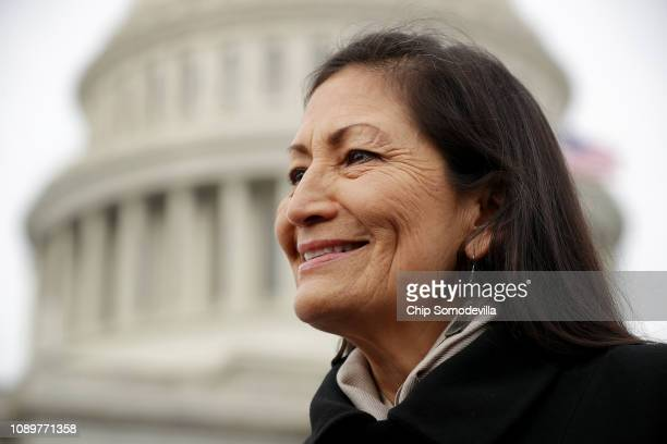 Rep Debra Haaland talks with reporters after a portrait with her fellow House Democratic women in front of the US Capitol January 04 2019 in...