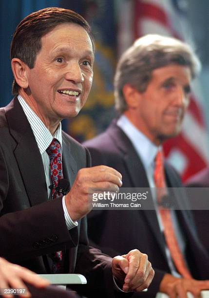 Rep. Dennis Kucinich answers a question as Sen. John Kerry waits his turn during a town hall meeting of Democratic presidential candidates at the...