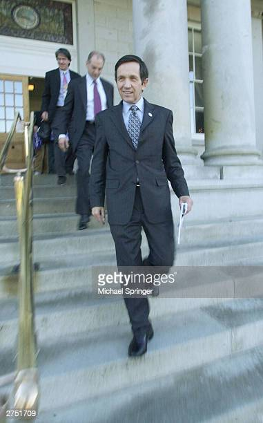 S Rep Dennis Kucinich walks out of the New Hampshire Statehouse after signing papers to officially enter the state's Democratic presidential primary...