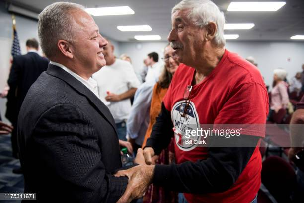 Rep. Denver Riggleman, R-Va., speaks with constituents after his joint town hall meeting with Rep. Ben Cline, R-Va., at Central Virginia Community...