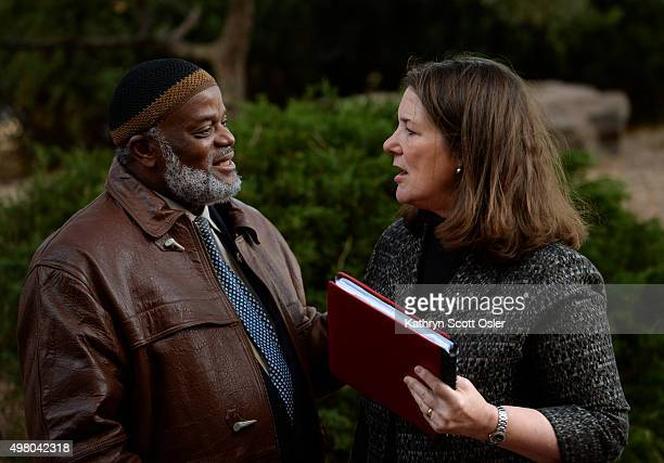 S Rep Diana DeGette right greets Imam AbdurRahim Ali leader of the Northeast Denver Islamic Center who has joined a small crowd gathered for a press...
