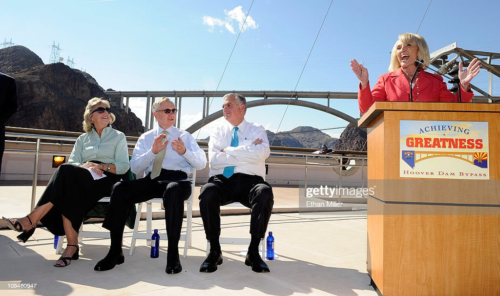 U.S. Rep. Dina Titus (D-NV), U.S. Senate Majority Leader Harry Reid (D-NV) and U.S. Transportation Secretary Ray LaHood listen as Arizona Gov. Jan Brewer speaks at the dedication of the Mike O'Callaghan-Pat Tillman Memorial Bridge part of the Hoover Dam Bypass Project October 14, 2010 in the Lake Mead National Recreation Area, Nevada. The 1,900-foot-long structure sits 890 feet above the Colorado River, about a quarter of a mile downstream from the Hoover Dam. The USD 240 million project to relieve vehicle traffic on the Hoover Dam began in 2003, and is scheduled to be open to traffic by next week.