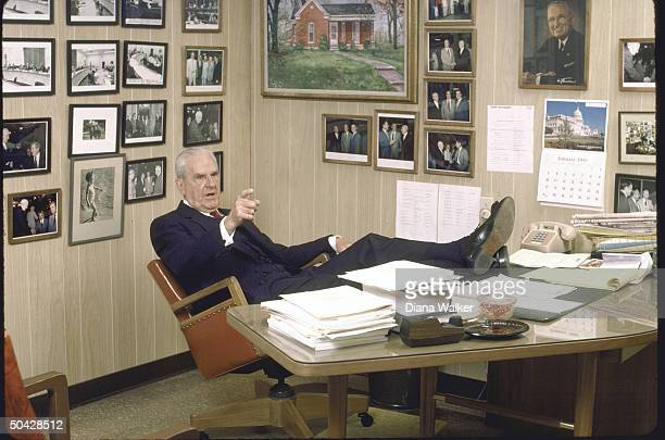 Rep. D-Ky. William H. Natcher, sitting with feet proped up on desk.