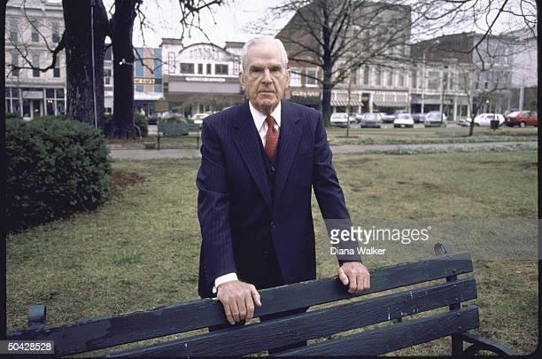 Rep. D-Ky. William H. Natcher, standing behind park bench.