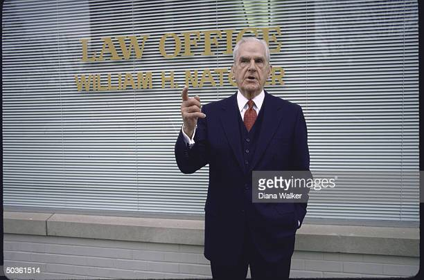 Rep. D-Ky. William H. Natcher, standing outside law office.