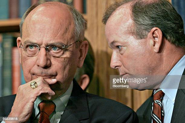 U S Rep Doc Hastings chairman of the House ethics committee left and listens to Ed Cassidy his chief of staff during a news conference in Washington...
