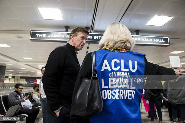 Rep Don Beyer DVa speaks with an ACLU legal observer during the protest at Dulles International Airport in Virginia on Sunday Jan 29 2017 Protests...