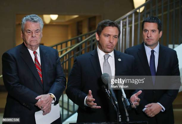 Rep Don DeSantis speaks while flanked by House Intelligence Committee Chairman Devin Nunes and Rep Peter King as they announce that the House...