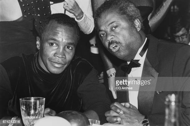 Rep Donald M Payne DNJ talks with boxer Sugar Ray Leonard a guest on Nov 11 1991