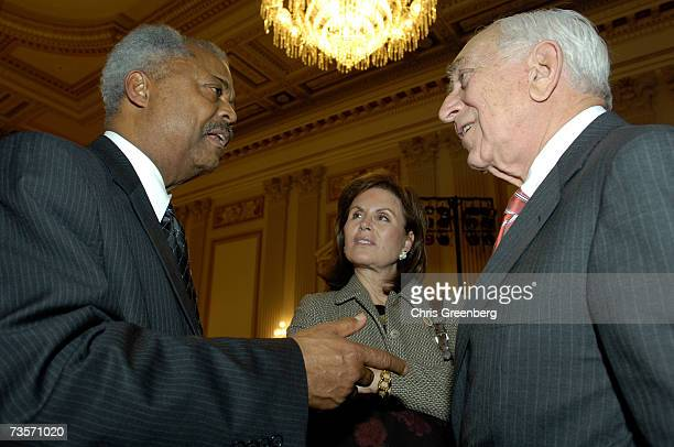 Rep Donald Payne gestures to make a point to Senator Frank Lautenberg and his wife Bonnie Lautenberg during the American Society of Composers Authors...