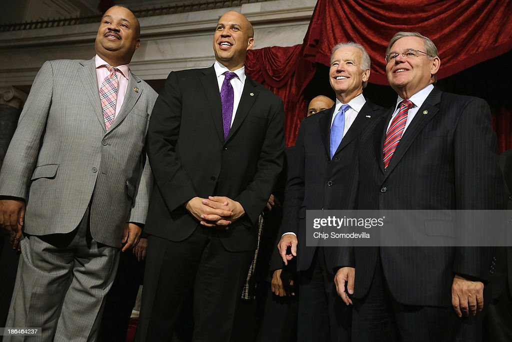 Rep. Donald Payne Jr. (D-NJ), Sen. Cory Booker (D-NJ), Vice President Joe Biden and Sen. Robert Menendez (D-NJ) pose for photographs after Booker's ceremonial swearing-in in the Old Senate Chamber at the U.S. Capitol October 31, 2013 in Washington, DC. Booker defeated Republican Steve Lonegan in a special election to replace Frank Lautenberg, who died in June.