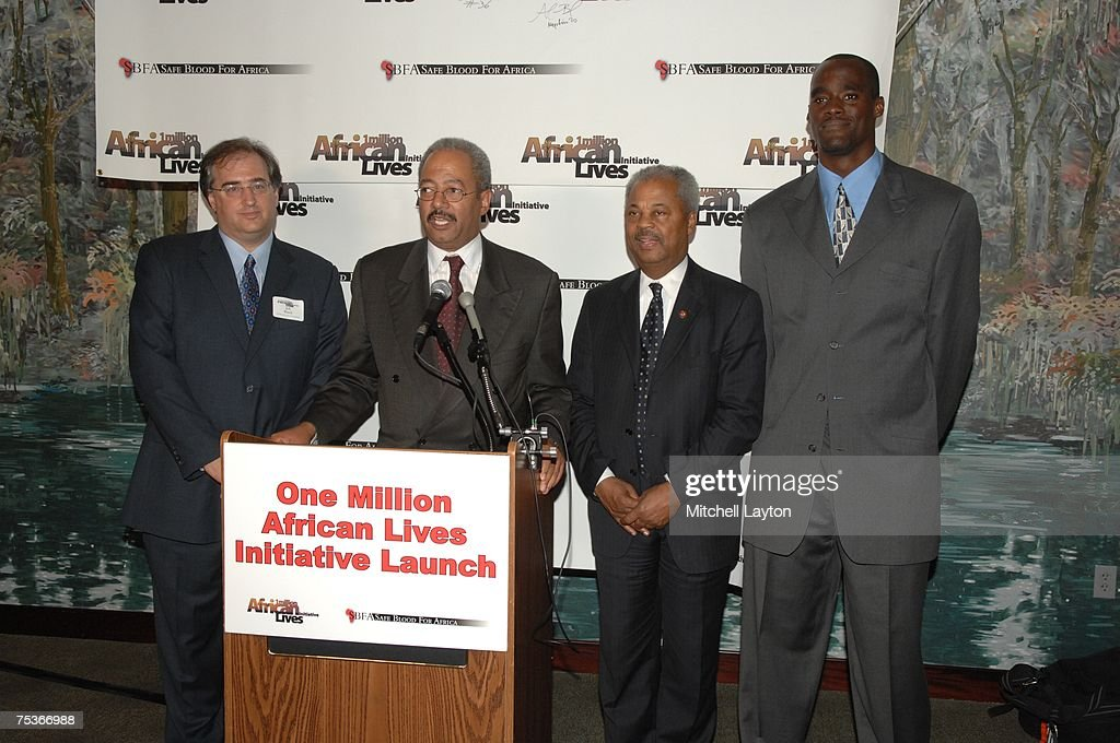 Rep. Donald Payne (D-NJ), Rep. Chaka Fattah (D - PA) and Emeka Okafor of the Charlotte Bobcats attend the first annual 'One Million African Lives' Congressional reception at Acadiana restaurant on July 11, 2007 in Washington, DC.