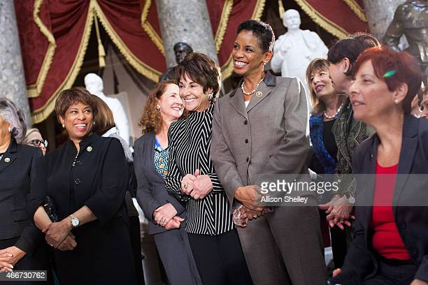 S> Rep Donna Edwards C and other attendees listen at an annual Women's History Month reception hosted by Democratic House Leader Nancy Pelosi in the...