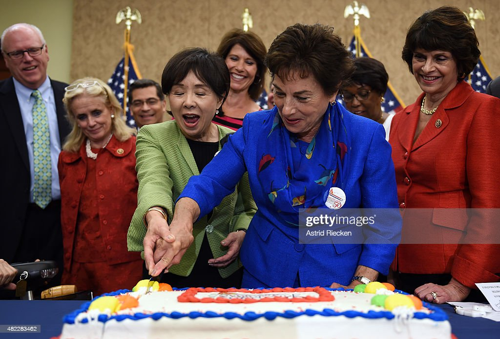 Rep. Doris Matsui (D-CA), and Rep. Jan Schakowsky (D-IL) cut a special cake to celebrate the 50th anniversary of Medicare and Medicaid on Capitol Hill on July 29, 2015 in Washington, DC. Fellow Senate and House lawmakers, who oppose any cuts to the important program for seniors, look on.