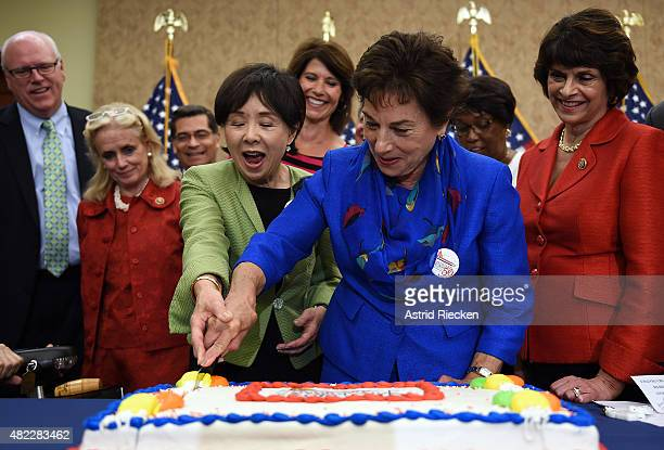 Rep Doris Matsui and Rep Jan Schakowsky cut a special cake to celebrate the 50th anniversary of Medicare and Medicaid on Capitol Hill on July 29 2015...