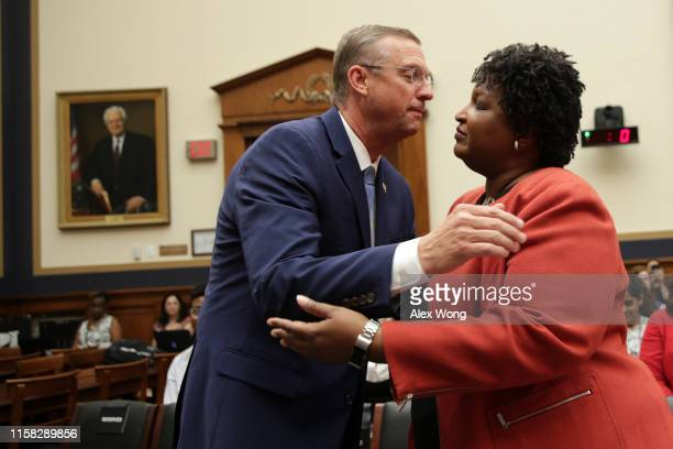 S Rep Doug Collins greets former Democratic leader in the Georgia House of Representatives and founder and chair of Fair Fight Action Stacey Abrams...