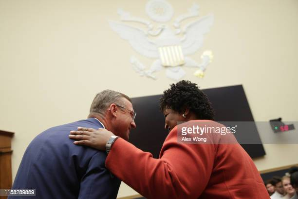 S Rep Doug Collins talks to former Democratic leader in the Georgia House of Representatives and founder and chair of Fair Fight Action Stacey Abrams...