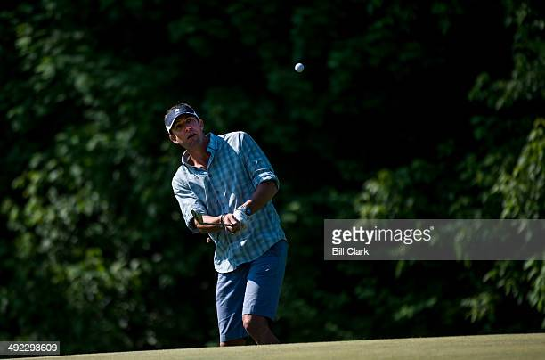 Rep Duncan Hunter RCalif chips to the green during the First Tee Congressional Challenge golf tournament at the Columbia Country Club in Chevy Chase...