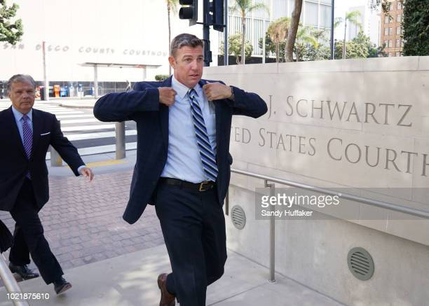 Rep Duncan Hunter walks into the Federal Courthouse for an arraignment hearing on August 23 2018 in San Diego California Hunter and his wife Margaret...