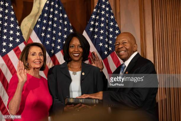 Rep Elijah Cummings and his wife Maya Rockeymoore Cummings participate in a ceremonial swearingin ceremony with House Speaker Nancy Pelosi on Capitol...