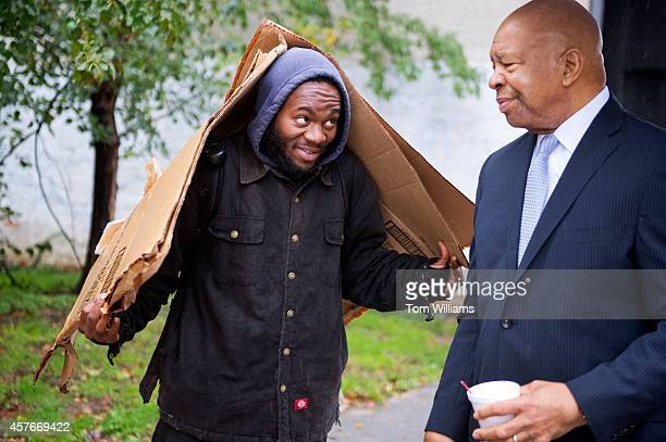 Rep Elijah Cummings DMd talks with a constituent in between events in Baltimore Md October 22 2014