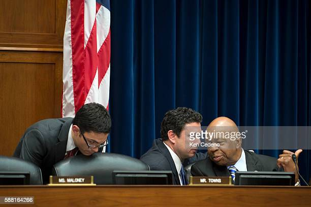 Rep Elijah Cummings right confers with Rep Jason Chaffetz center during a House Oversight and Government Reform Committee hearing on Capitol Hill in...