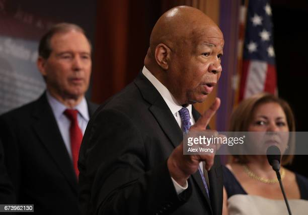 S Rep Elijah Cummings speaks as Sen Tom Udall and Rep Linda Sanchez look on during a news conference at the Capitol April 27 2017 in Washington DC...