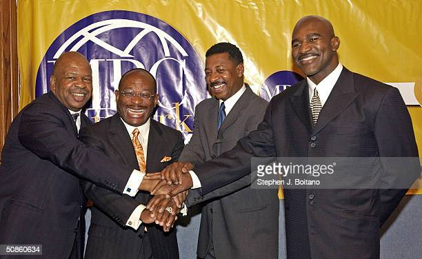 Rep Elijah Cummings Willie Gary CEO of MBC Robert Townsend President of MBC Productions and Evander Holyfield former heavy weight champion pose at an...
