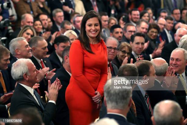 Rep. Elise Stefanik stands as she's acknowledged by U.S. President Donald Trump as he speaks one day after the U.S. Senate acquitted on two articles...