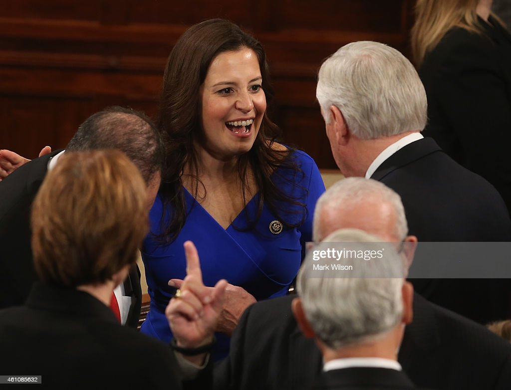 U.S. Rep. Elise Stefanik (R-NY) (C) talks with other members during the first session of the 114th Congress in the House Chambers January 6, 2015 in Washington, DC. Today Congress convened its first session of the 114th Congress with Republicans controlling both the House and Senate.