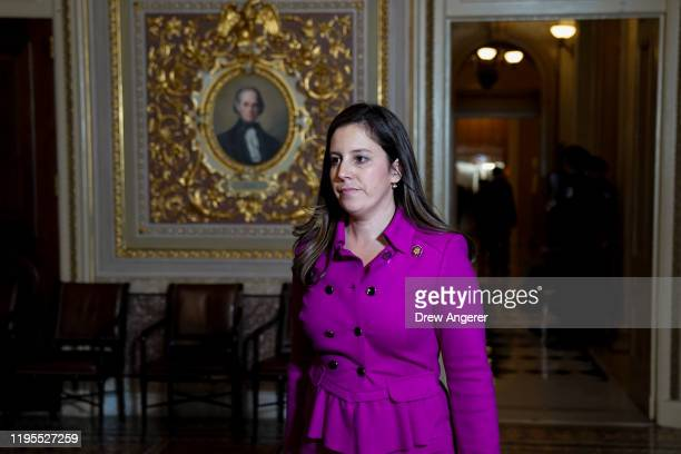 Rep. Elise Stefanik walks to an office being used by President Donald Trump's defense team off the Senate floor during the impeachment trial of...
